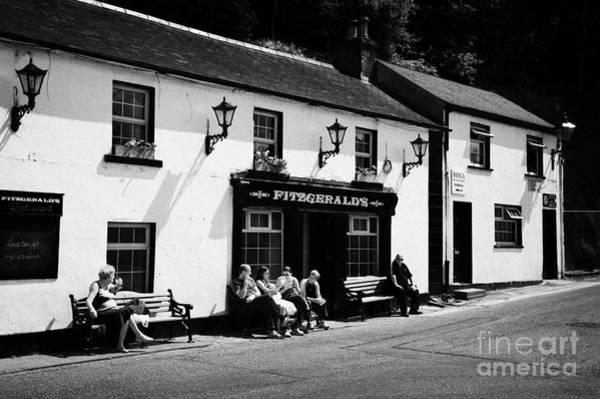 Wall Art - Photograph - Tourists Outside Fitzgeralds Pub In The Village Of Avoca From The Tv Series Ballykissangel by Joe Fox