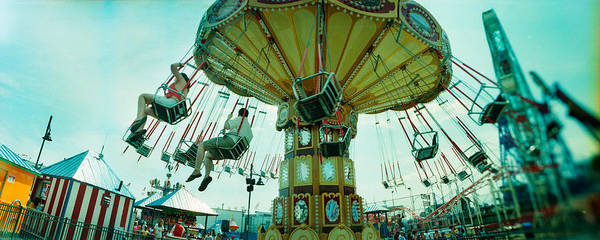Trapeze Photograph - Tourists Riding On An Amusement Park by Panoramic Images