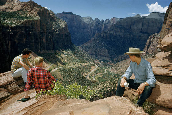 Wall Art - Photograph - Tourists Sit On Rocky Outcrop by Justin Locke