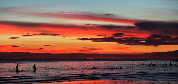 Wall Art - Photograph - Tourists Swimming In Sea At Sunset by Per-Andre Hoffmann
