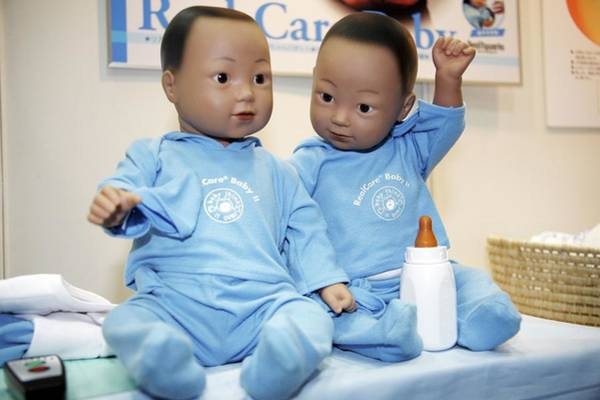 Realistic Photograph - Toy Baby Robots by Andy Crump/science Photo Library