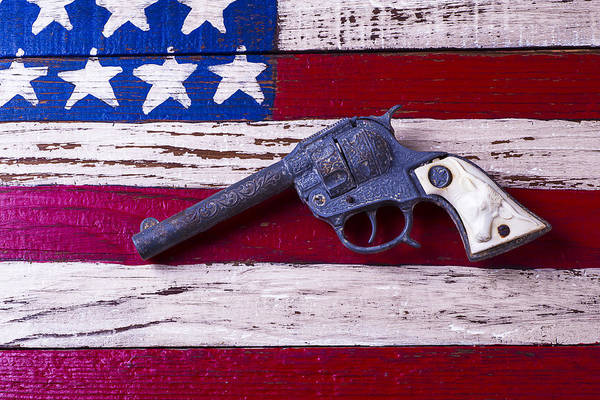 Toy Gun Photograph - Toy Gun On Wooden Flag by Garry Gay