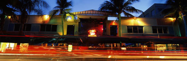 Dade Photograph - Traffic In Front Of A Building At Dusk by Panoramic Images