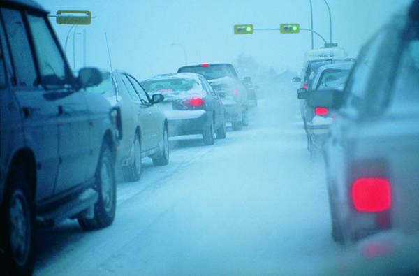 Traffic Jam In Snowy Conditions Art Print by Digital Vision.