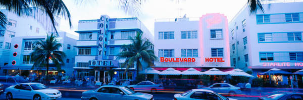 Sidewalk Cafe Photograph - Traffic On Road In Front Of Hotels by Panoramic Images