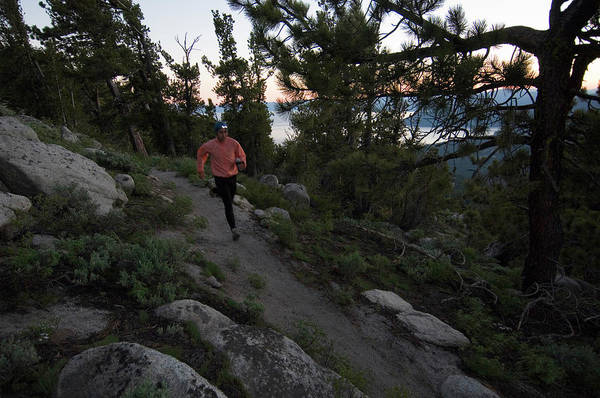 Workout Photograph - Trail Runner With Headlamp by Lars Schneider