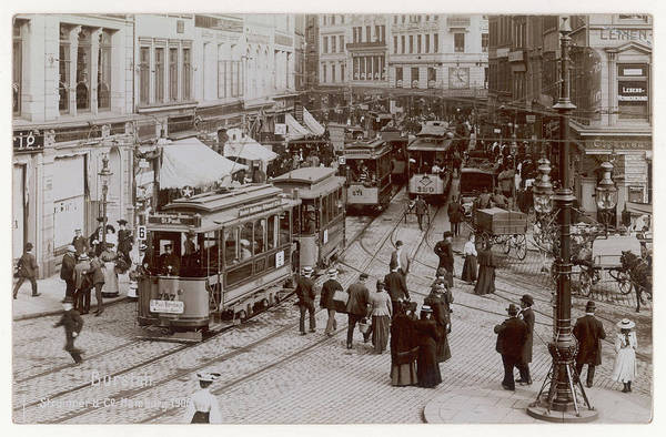Wall Art - Photograph - Trams Dominate This Busy Scene by Mary Evans Picture Library
