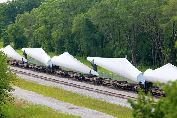 Blades Photograph - Transporting Wind Turbine Blades by Jim West