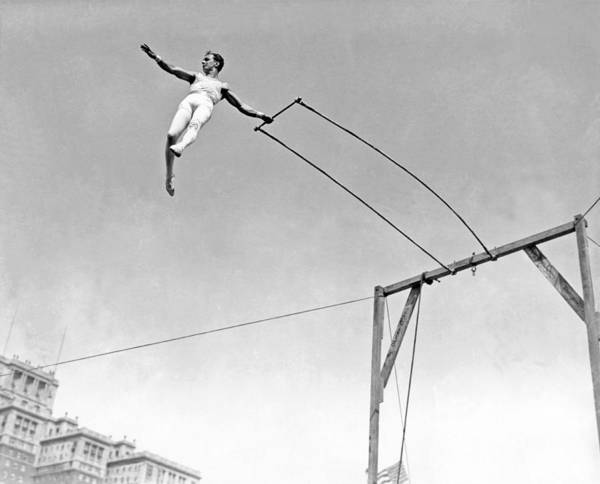 Gymnast Wall Art - Photograph - Trapeze Artist On The Swing by Underwood Archives
