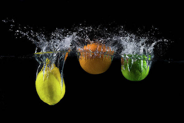 Citrus Fruit Photograph - Triple Citrus Splash by Mogyorosi Stefan