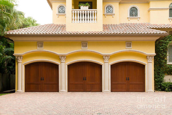 Photograph - Triple Garage Doors by Les Palenik