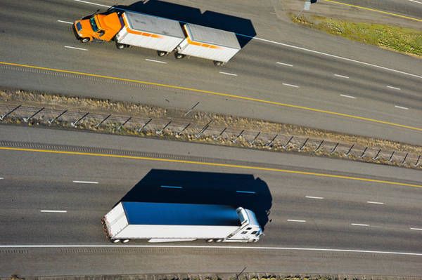 Trailer Photograph - Trucks Moving On A Highway, Interstate by Panoramic Images
