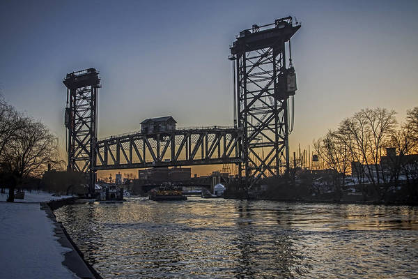 Photograph - Tug Boat Under A Vertical Lift Bridge by Sven Brogren