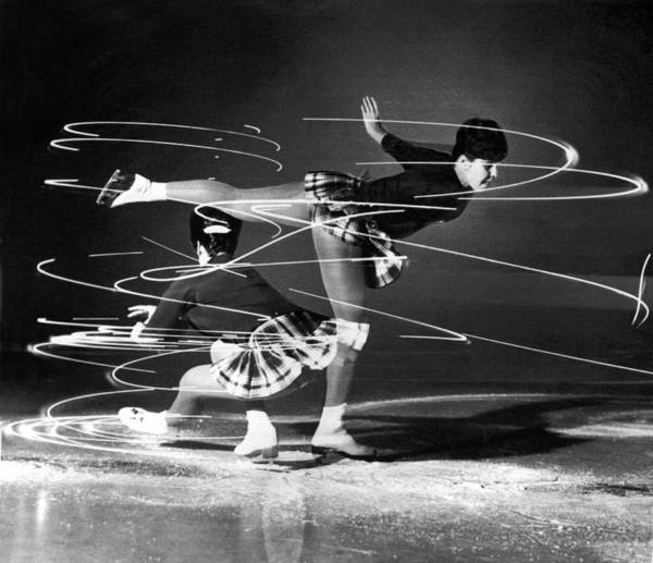 Nightime Photograph - Twirling Lights And Spins On Ice by Underwood Archives