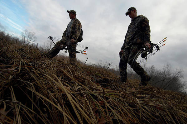 End Of The Trail Photograph - Two Bow Hunters Walking Through A Field by Joel Sheagren