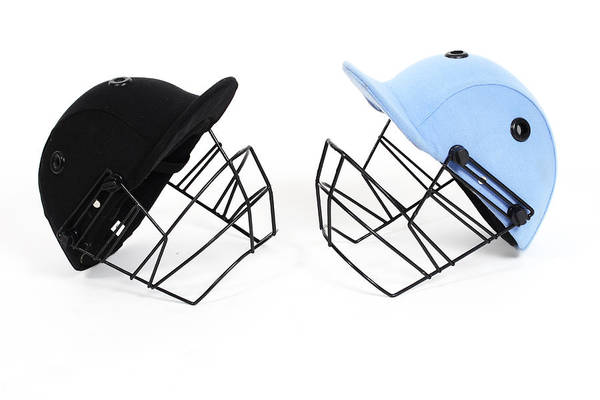 Crash Helmet Photograph - Two Cricket Helmets Facing Each Other by Visage