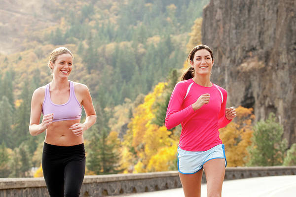 Wall Art - Photograph - Two Females Smile While Jogging by Jordan Siemens