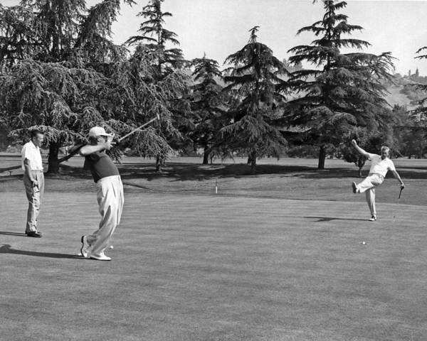 Photograph - Two Golfers Body English by Underwood Archives