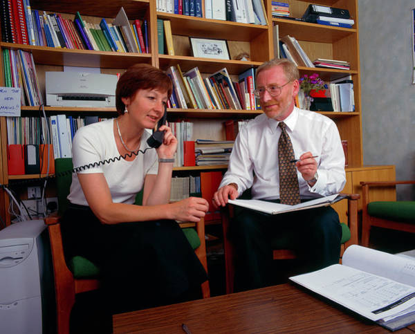Staff Photograph - Two Hospital Managers Discuss Hospital Issues by Simon Fraser/science Photo Library