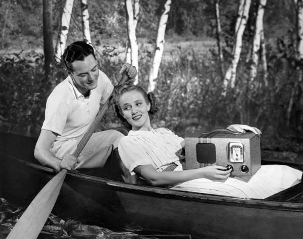 Birch River Photograph - Two Lovers In A Canoe by Underwood Archives