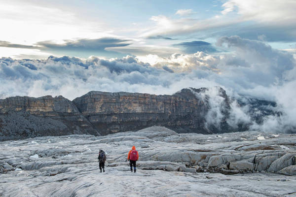 Boyaca Photograph - Two Men Hiking On Rocky Field At Sierra by Marcos Ferro