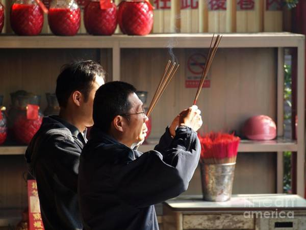 Chinese New Year Photograph - Two Men Pray For The Chinese New Year by Yali Shi