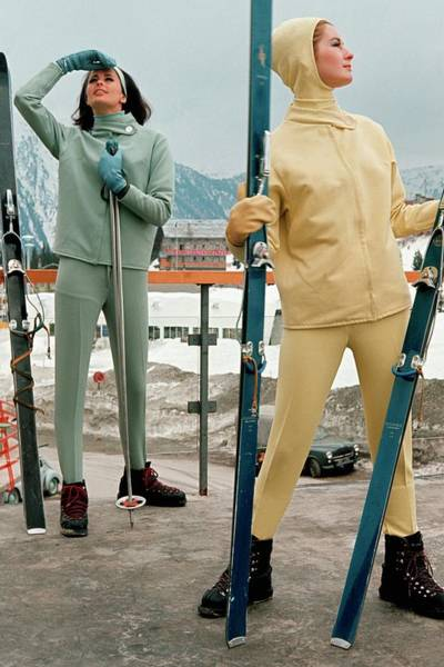 Headband Photograph - Two Models At A Ski Resort Wearing Outfits by Frances McLaughlin-Gill