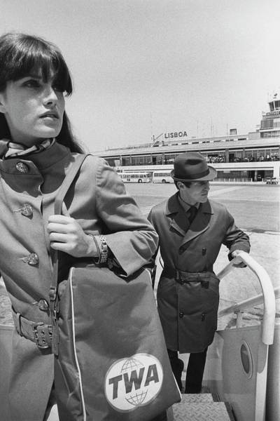Iberian Peninsula Photograph - Two Models Boarding A Plane by Leonard Nones