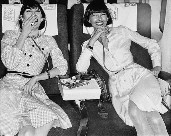 Commercial Airplane Photograph - Two Models Laughing At A Movie In An Iberia 747 by Chris von Wangenheim