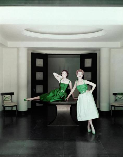 Photograph - Two Models Posing By A Table by John Rawlings