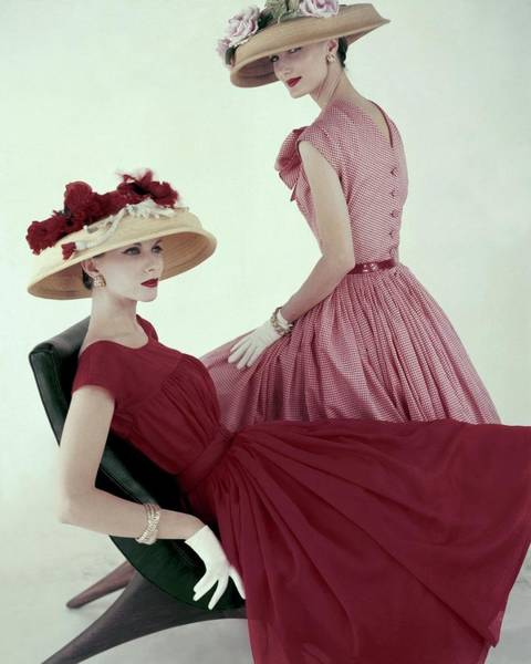 Two People Photograph - Two Models Wearing Red Dresses by Karen Radkai