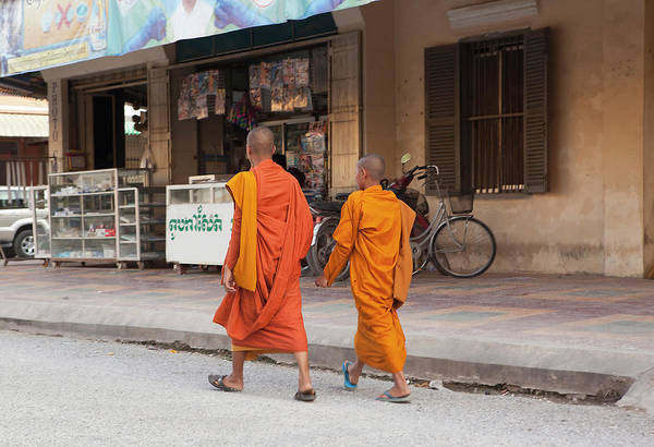 Cambodian Photograph - Two Monks In The Street In Battambang by Cormac Mccreesh
