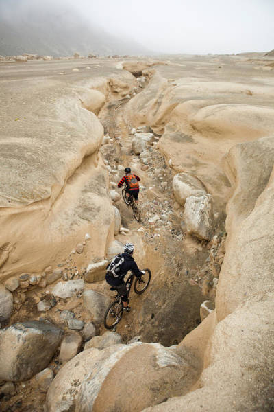 Lima Photograph - Two Mountain Bikers Ride Down A Dried by Dan Barham