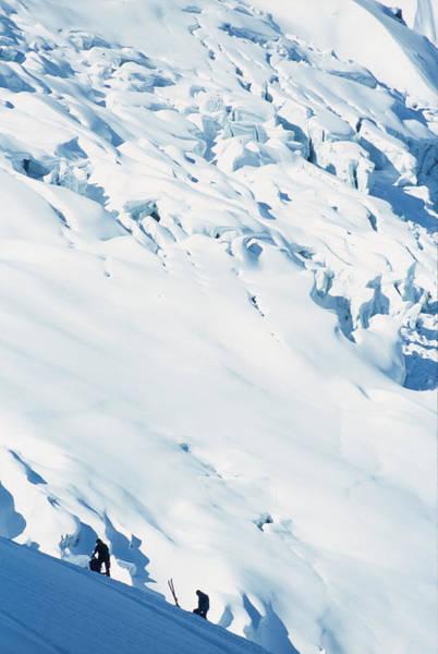 Chamonix Wall Art - Photograph - Two Mountaineers High On The Slopes by Heath Korvola