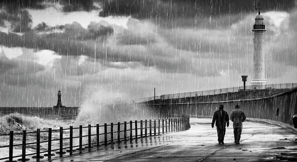 Walking In The Rain Wall Art - Photograph - Two People Walking Along The Water S by John Short