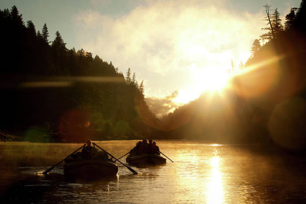 Raft Wall Art - Photograph - Two Rafts On A River Silhouetted by Trevor Clark
