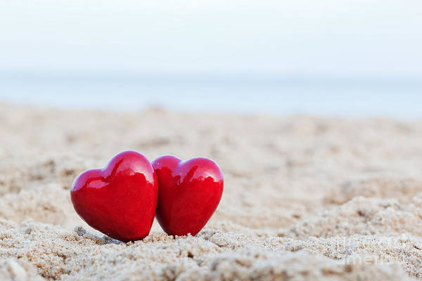 Pure Love Wall Art - Photograph - Two Red Hearts On The Beach Symbolizing Love by Michal Bednarek