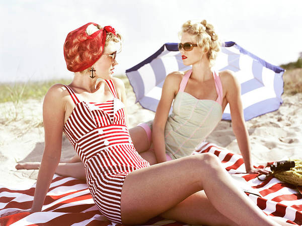 Parasol Photograph - Two Retro Young Women On Beach by Johner Images