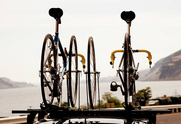 Bicycle Rack Photograph - Two Road Bikes Mounted On Top Of A Car by Jordan Siemens