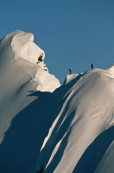 Haines Falls Photograph - Two Skiers On Top Of A Snowy Mountain by Adam Clark