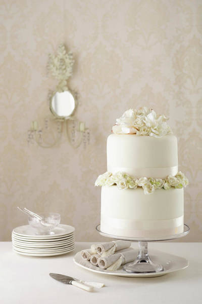 Coral Photograph - Two Tier Wedding Cake With Knife And by Brett Stevens