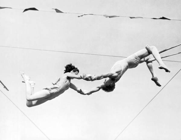 Stunt Photograph - Two Trapeze Artists by Underwood Archives