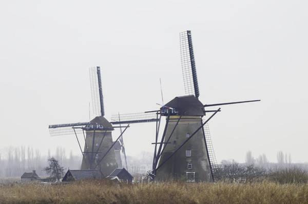 Blye Photograph - Two Windmills At Kinderdijk by Kenneth Blye