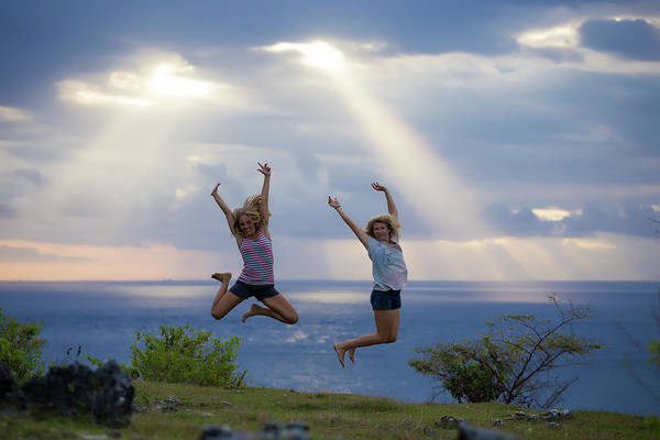 All Together Photograph - Two Women Jumping On Ocean Coastline by Konstantin Trubavin