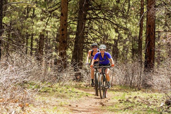 Determination Photograph - Two Women Mountain Biking On The Boggy by Kennan Harvey