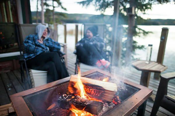 Wall Art - Photograph - Two Women Sitting Around Campfire by Christopher Kimmel