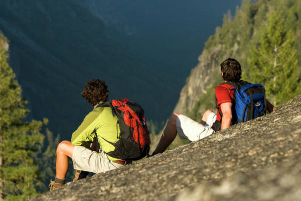 All Together Photograph - Two Young Men Taking In The View While by Justin Bailie