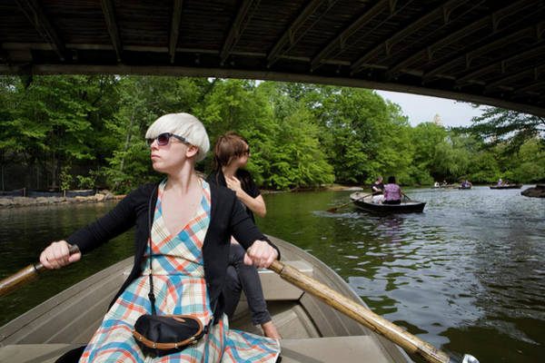 Wall Art - Photograph - Two Young Women Are Row Boating by Katja Heinemann