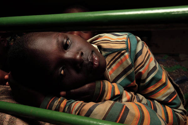 Sacred Heart Photograph - Ugandan Child In A Refuge by Mauro Fermariello/science Photo Library