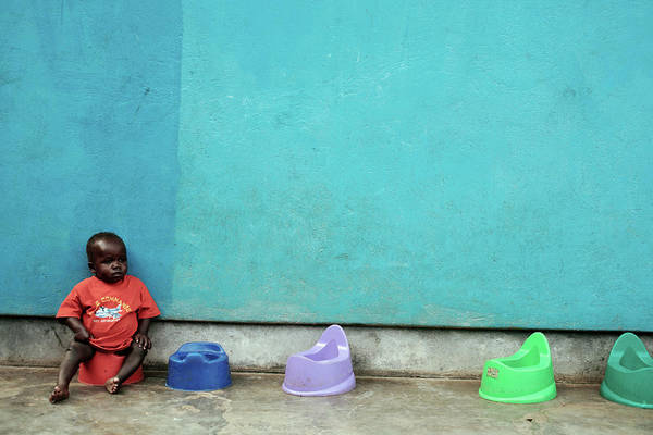 Outside Toilet Photograph - Ugandan Child On A Potty by Mauro Fermariello/science Photo Library